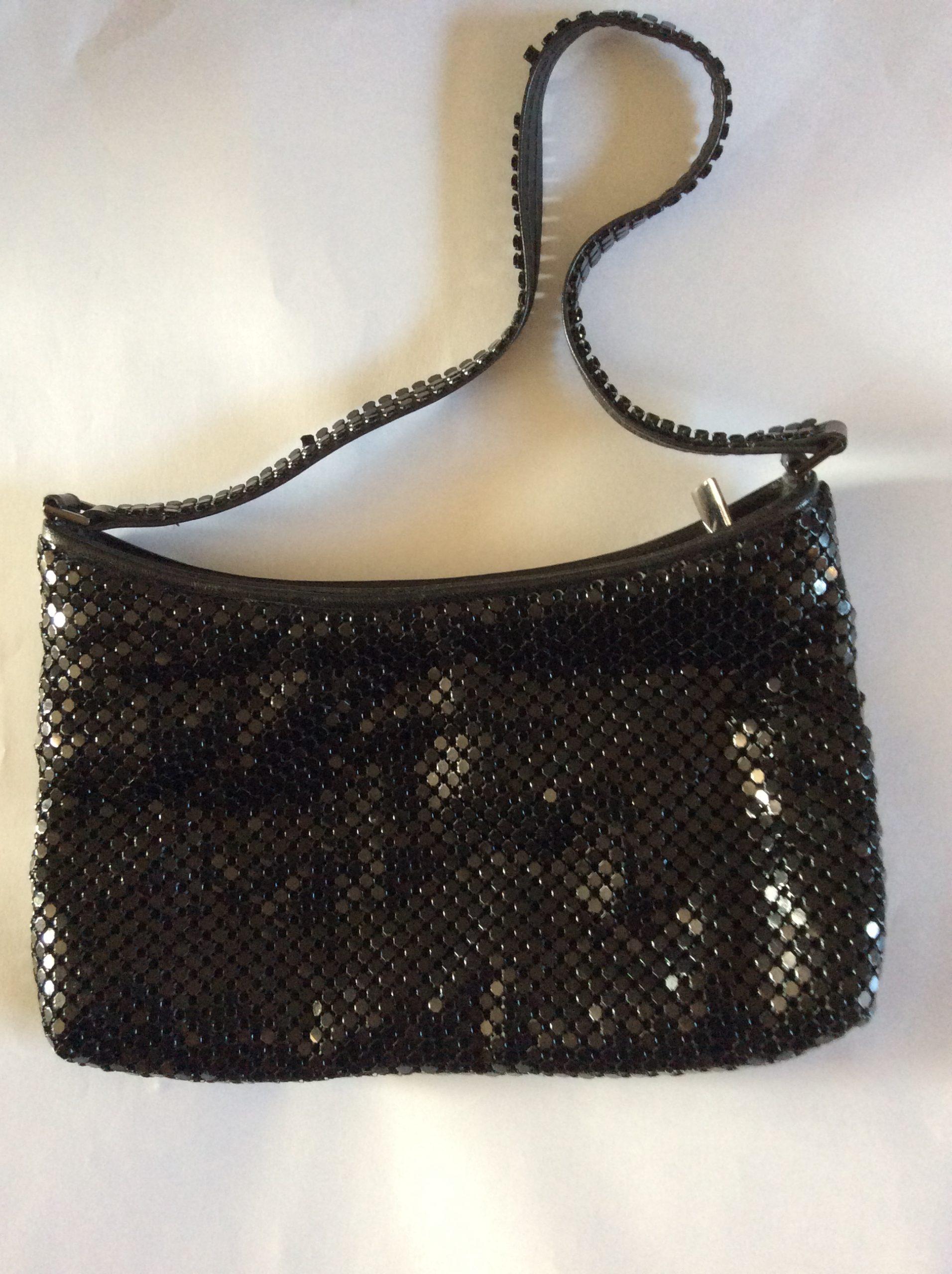 Small metallic black handbag